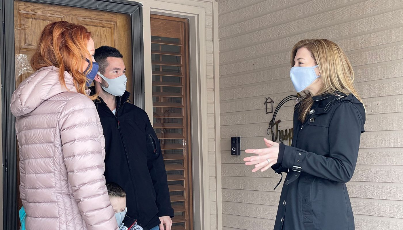 Sara knocking doors for her campaign